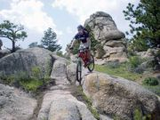 Curt-Gowdy-biking-down-rock